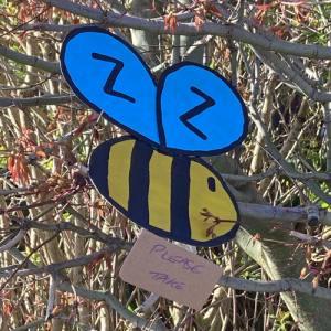 Cardboard bee hanging in a tree